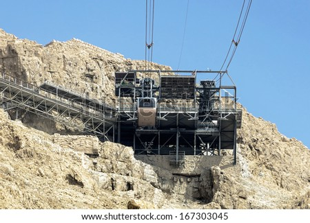The cable car transporting passengers in fortress Masada - Israel - stock photo