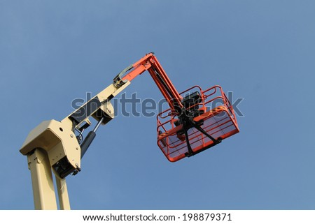 The Cage and Arm of a Mechanical Cherry Picker Lift. - stock photo