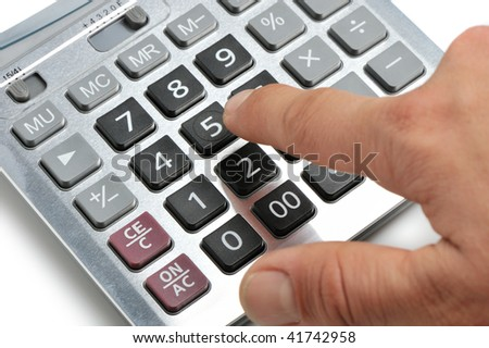 The calculator and a hand of the man. Pressing of a key of the calculator