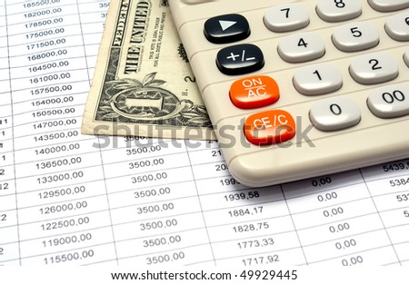 The calculator and dollar lie on the schedule of payments under the credit - stock photo