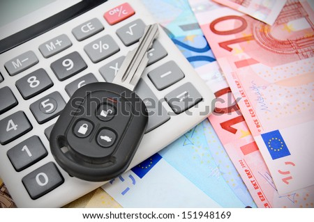 The calculator and key car - stock photo