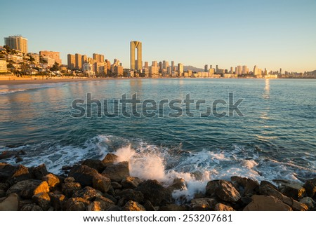 The calm waters of  Benidorm bay on a sunny morning - stock photo