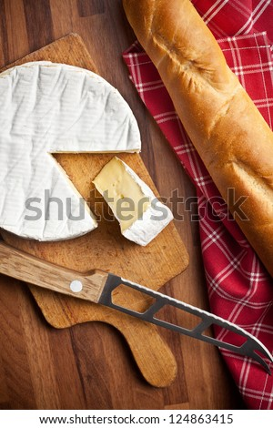 the camembert cheese on kitchen table - stock photo