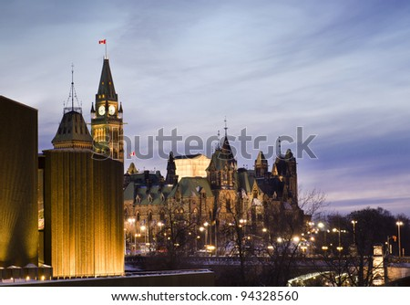 The Canadian Parliament Centre and East blocks  seen from the National Art Centre in Ottawa, Canada. - stock photo