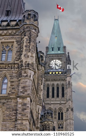 The canadian Parliament on a summer afternoon with angry clouds. - stock photo