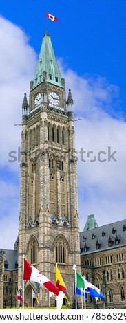 The Canadian Parliament Peace Tower with provincial flags. - stock photo