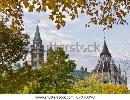 The Canadian Parliament seen from Major's Hill Park in Ottawa during autumn.
