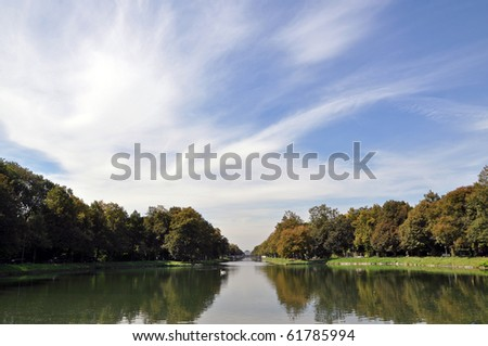 The canal leading to the baroque palace of Nymphenburg in Munich, Germany. - stock photo