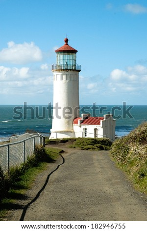 The Cape Disappointment  lighthouse in bright sunshine.