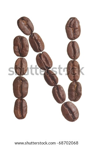 The capital letter N spelled in coffee beans, isolated on a white background. Macro resolution.