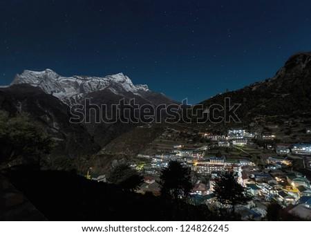 The capital of the sherpas Namche Bazar at night - Nepal, Himalayas - stock photo