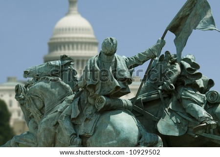 The Capitol Building in Washington, DC, framed by a detail of the Ulysses S. Grant Memorial. (The Grant Memorial includes the largest equestrian statue in the United States.) - stock photo
