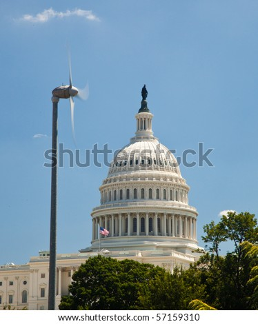 The Capitol building in Washington DC framed wind turbine generating alternative clean power