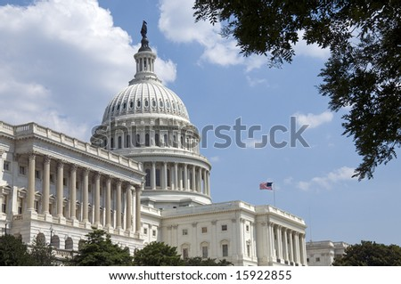 The Capitol, located in Washington, DC, is the building in which the United States Congress meets. It is at the east end of the National Mall. - stock photo