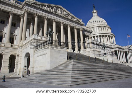 The Capitol, located in Washington, DC, is the building in which the US Congress meets. It is at the east end of the National Mall - stock photo
