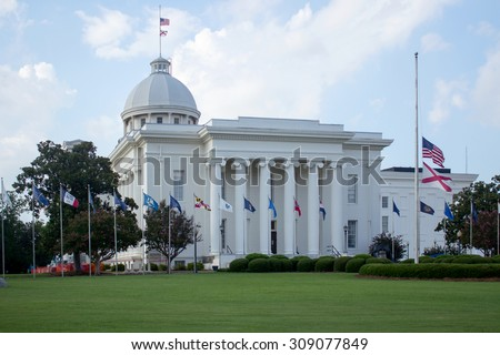 The Capitol of Alabama located in Montgomery, Alabama on  a sky background surrounded by flags/Capitol of Alabama/Alabama's Capitol surrounded by flags