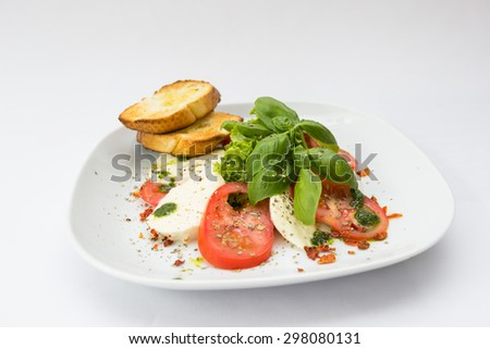 The caprese salad served in a restaurant - stock photo
