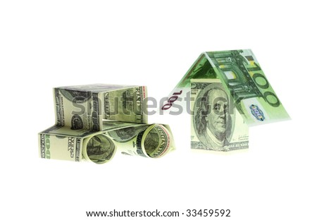 The car and the house made of Dollars and euro isolated on white background