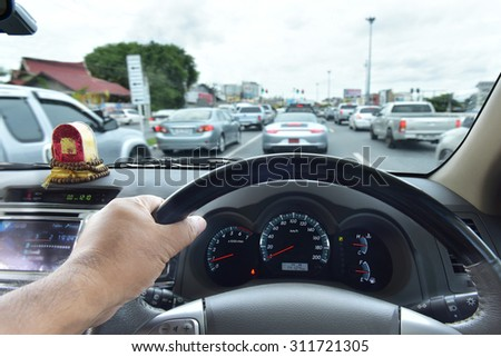 the car console, waiting in a traffic jam - stock photo