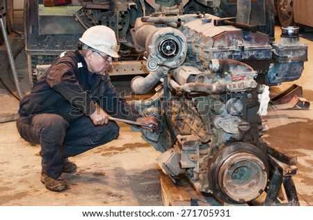 The car mechanic repairs the truck engine - stock photo
