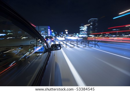 The car moves at great speed at the night - stock photo