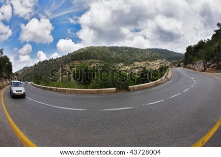 "The car on abrupt turn of the mountain road, photographed by an objective "" Fish eye"