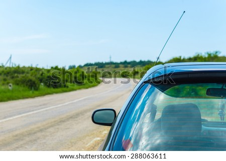 The car on the road landscape background