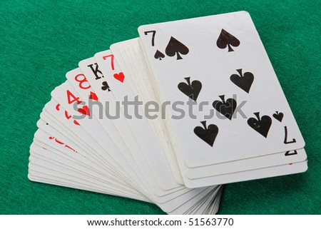 The cards on the green background