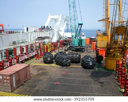 The cargo ship with the crane, the top view. Pipelaying barge. - stock photo
