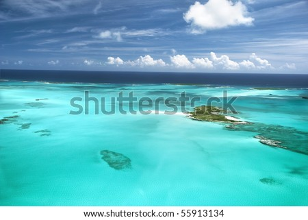 The caribbean ocean, sandbars and islands. An incredible and surreal scene in the beautiful Bahamas. - stock photo