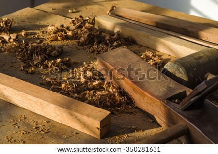 The carpenter was working furniture wood in studio - stock photo