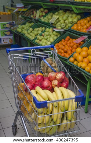 the cart with fruit in a supermarket - stock photo