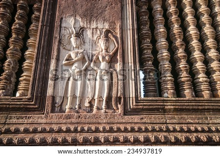 The carved stone ancient ruins of a historic Khmer temple in Angkor Wat temple in Siem Reap,Cambodia.Angkor Wat is the largest Hindu temple complex and religious monument in the world - stock photo
