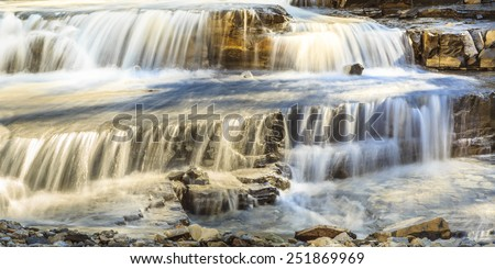 The cascading stream of water at these waterfalls in Waterton Lakes National Park in Alberta, Canada. - stock photo