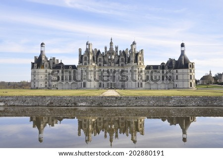 The castle and its reflection in the loire valley, France - stock photo