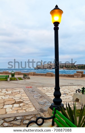 The castle of El Morro in Havana at sunset with a stormy sea - stock photo