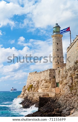 The castle of El Morro in Havana with a waving cuban flag - stock photo