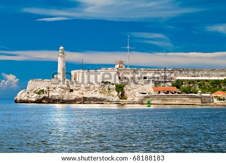 The Castle of El Morro in the bay of Havana with reflections in the water - stock photo