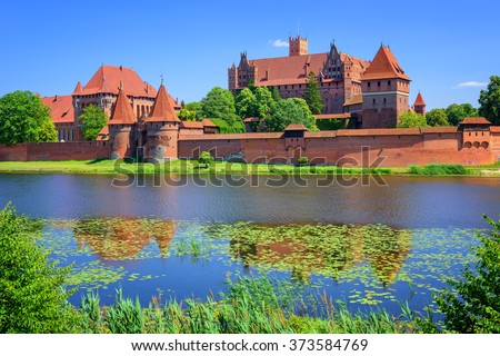 The Castle of the Teutonic Knights Order in Malbork, Poland, historical Prussia, is the largest castle in the world - stock photo