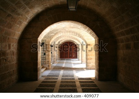 The catacomb of an old castle... - stock photo