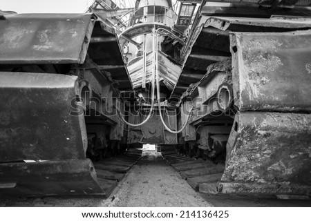 the caterpillar tracks of a mining machine - stock photo