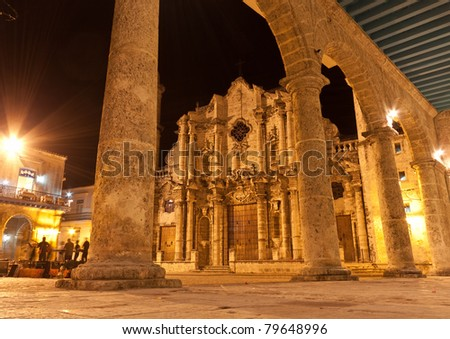 The Cathedral of Havana and its adjacent square illuminated at night - stock photo