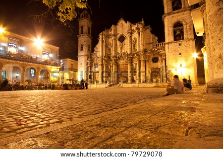 The Cathedral of Havana and its adjacent square in the colonial neighborhood of Old Havana illuminated at night - stock photo