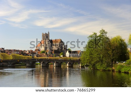 The Cathedral of Saint Etienne at Auxerre, from the Yonne River. Space for text in the sky. - stock photo