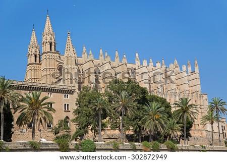 the Cathedral of Santa Maria of Palma and Parc del Mar near, Majorca, Spain - stock photo
