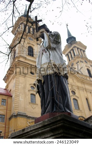 The catholic church and statue of of Radna, Romania - stock photo