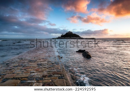 The causeway at high tide leading to St Michaels Mount at Marazion near Penzance in Cornwall - stock photo