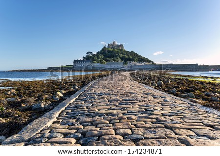 The causeway at low tide leading to St Michaels Mount at Marazion near Penzance in Cornwall - stock photo