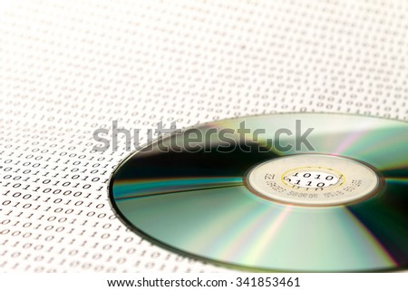 the CD on the background of binary code - stock photo