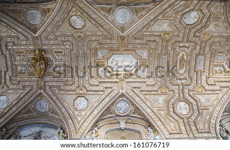 The ceiling of Saint Peters Basilica in the Vatican City - stock photo